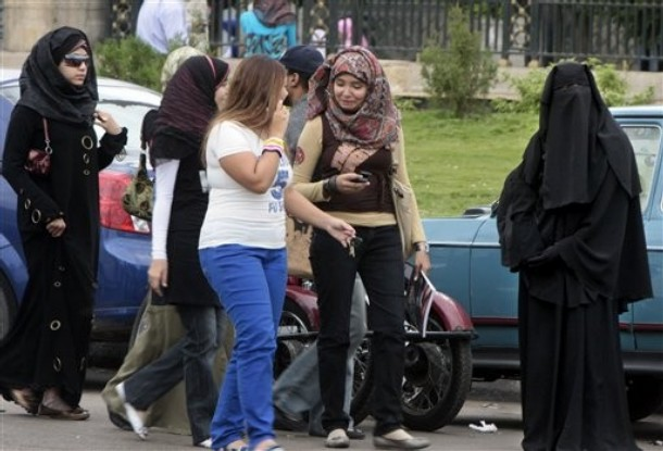 This Oct. 29, 2009 photo shows an Egyptian woman in Cairo, right, wearing the niqab, which covers everything but the eyes. Egypt's secular-leaning government, backed by a leading cleric, has banned the niqab in college dormitories and some professions, stirring fierce debate in the Arab world's most populous country. (AP Photo/Amr Nabil) (AP Photo/Amr Nabil)